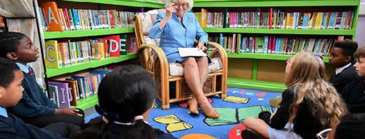 Local school children welcome Her Royal Highness The Duchess of Cornwall in celebration of reading